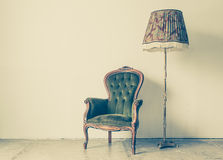 Vintage and antique chair with white wall Stock Photos