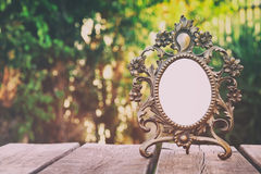 Vintage antique classical frame on wooden table Stock Images