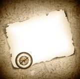 Vintage antique compass at burned paper Royalty Free Stock Photos