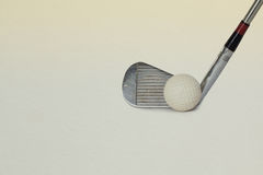 Vintage, antique golf driver. (putter) and ball. golf club. retro paper background (toned Stock Photography