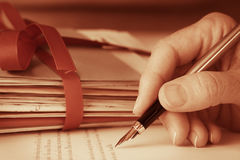 Vintage Antique Hand with Fountain Pen Writing Letters Closeup Royalty Free Stock Images