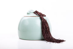 Vintage or antique light green tea canister with tassel isolated Stock Images