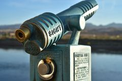 Vintage coin operated telescope. Vintage antique old fashioned coin operated telescope outdoors along Colorado river bank for magnified viewing of scenery Stock Images