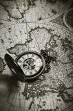 Vintage antique pocket watch on old map background. Close up Royalty Free Stock Image