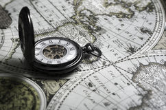 Vintage antique pocket watch on old map background. Close up Royalty Free Stock Photo