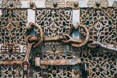 Vintage antique rusty steel door with round handles. Close up royalty free stock photos