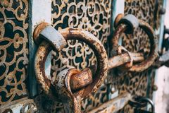 Vintage antique rusty steel door with round handles. Close up stock photography