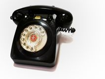 A vintage and antique telephone with white background. royalty free stock photography