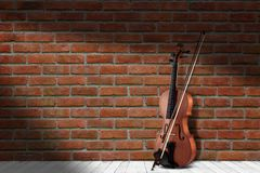 Vintage antique violin near brick wall background. royalty free stock images