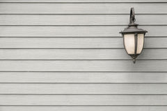 Vintage Antique wall lamp on grey wood wall, for background with Stock Photo