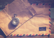 Vintage antique watches and airmail letter on wood table Stock Image