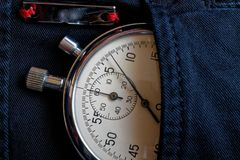 Vintage antiques Stopwatch, in black jeans pocket with reflection plank, value measure time, old clock arrow minute, second accura Stock Photos