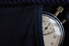Vintage antiques Stopwatch, in black denim pocket, value measure time, old clock arrow minute, second accuracy timer record Stock Photos