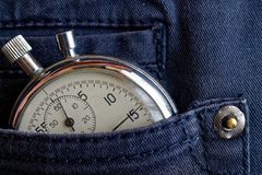 Vintage antiques Stopwatch, in blue jeans pocket, value measure time, old clock arrow minute, second accuracy timer record Royalty Free Stock Images