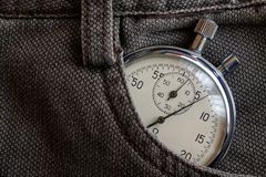 Vintage antiques Stopwatch, in brown denim pocket, value measure time, old clock arrow minute, second accuracy timer record Royalty Free Stock Image