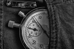 Vintage antiques Stopwatch, in denim pocket, value measure time, old clock arrow minute, second accuracy timer record. Vintage antiques Stopwatch, in black denim Royalty Free Stock Images