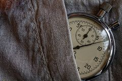 Vintage antiques Stopwatch, in linen pocket, value measure time, old clock arrow minute, second accuracy timer record.  Stock Photo