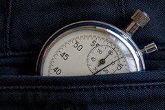 Vintage antiques Stopwatch, in new back denim pocket, value measure time, old clock arrow minute, second accuracy timer record Royalty Free Stock Photography