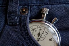 Vintage antiques Stopwatch, in old blue jeans pocket, value measure time, old clock arrow minute, second accuracy timer record Stock Photography
