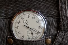 Vintage antiques Stopwatch, in old brown jeans pocket, value measure time, old clock arrow minute, second accuracy timer record Stock Image