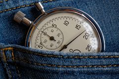 Vintage antiques Stopwatch, in old dark blue denim pocket, value measure time, old clock arrow minute, second accuracy timer recor Stock Images