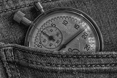 Vintage antiques Stopwatch, in old dark jeans pocket, value measure time, old clock arrow minute, second accuracy timer record.  Royalty Free Stock Photos