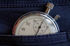 Vintage antiques Stopwatch, in old worn denim pocket, value measure time, old clock arrow minute, second accuracy timer record Stock Images
