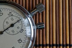 Vintage antiques Stopwatch, retro on wooden background, value measure time old clock arrow minute second accuracy timer record Royalty Free Stock Photo