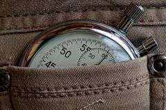Vintage antiques Stopwatch, in worn beige jeans pocket, value measure time, old clock arrow minute, second accuracy timer record Royalty Free Stock Photography
