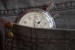 Vintage antiques Stopwatch, in worn brown denim pocket, value measure time, old clock arrow minute, second accuracy timer record Stock Images