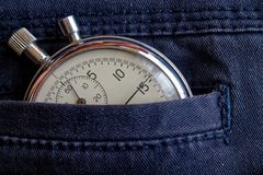Vintage antiques Stopwatch, in worn old denim pocket, value measure time, old clock arrow minute, second accuracy timer record Stock Image