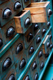 Vintage apothecary chest. Close up shot on an apothecary chest with open drawers Stock Photography