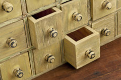 Vintage apothecary drawer cabintet. Drawers of primitive vintage grunge wood apothecary cabinet Stock Images