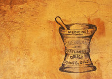 Vintage Apothecary Sign. On the side of an old building advertises medicine, drugs, chemicals and more royalty free stock image