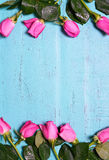 Vintage aqua blue wood background with pink rose buds. Royalty Free Stock Photography