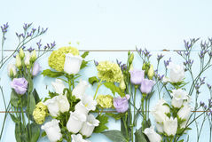 Vintage aqua green blue background with white, purple, lilac and yellow  flowers with empty copy space Stock Images
