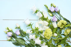 Vintage aqua green blue background with white, purple, lilac and yellow  flowers with empty copy space Royalty Free Stock Images