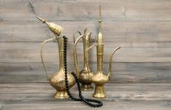 Vintage arabic jug Golden oriental decorations islamic rosary be Stock Image