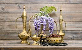 Vintage arabic jug lamp tea pot islamic rosary beads. Vintage arabic jug, vase, lamp, tea pot, islamic rosary beads. Fruits and flowers. Oriental holidays Royalty Free Stock Images