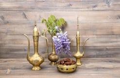 Vintage arabic jug vase tea pot Fruits flowers decoration. Vintage arabic jug, vase, tea pot. Fruits and flowers. Golden oriental decorations Stock Images