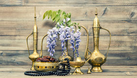 Vintage arabic pots islamic rosary beads Oriental holidays decor Stock Photos
