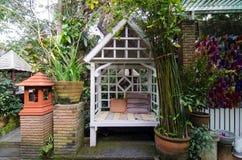 Vintage arbour in garden. White vintage arbour in garden Stock Photography
