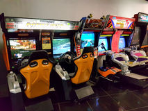 Vintage arcade gaming machines in the mall. MOSCOW, RUSSIA - AUGUST 13, 2016: Vintage arcade gaming machines in the mall. Nobody Stock Image