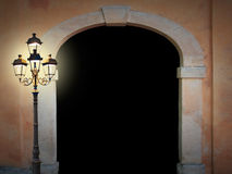 Vintage arched doorway with glooming lantern Stock Photography