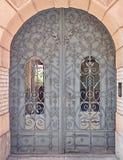 Vintage arched metallic door Stock Images