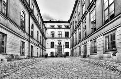 Vintage architecture in black and white. Black and white image of cobblestone street and old beautiful buildings Stock Images