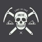 Vintage arctic skull with ice axes, mountains and slogan. Stock Images