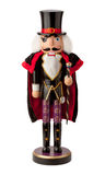 Vintage Aristocrat Nutcracker. Vintage wooden aristocrat nutcracker with a top hat and cape. This nobleman has white hair and a beard, and sports a black eye Stock Images