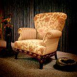 Vintage armchair. Stylish vintage armchair with pillow and flower in the vase stock image