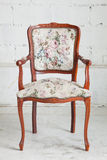 Vintage armchair. Wooden vintage armchair sofa in vintage room Stock Photography